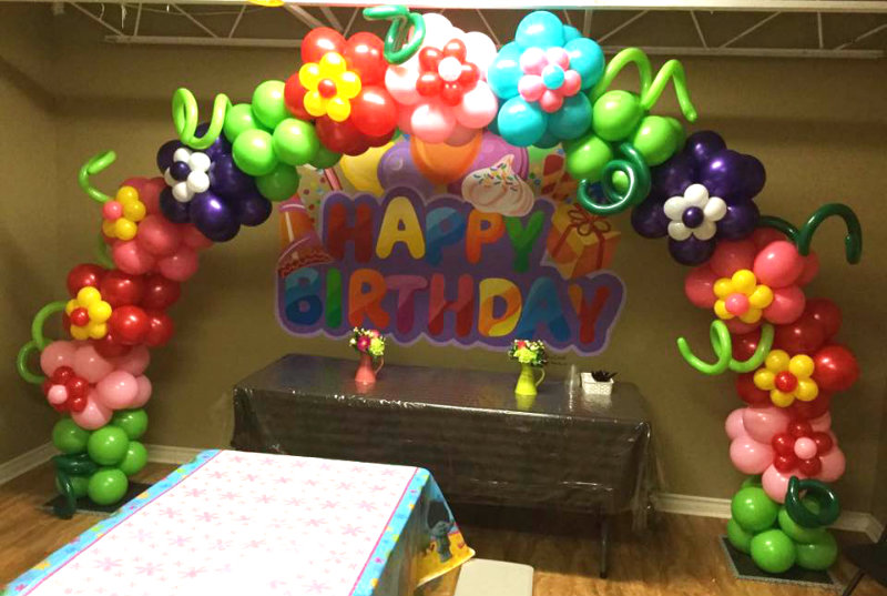 beautiful balloon decorations for themed parties - a colourful floral balloon arch for a child's birthday party