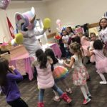 Unicorn mascot dancing at children's party