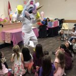 unicorn mascot performing at kids birthday party