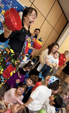 Kids entertainer Minerva MacIsaac performing a magic show at a birthday party